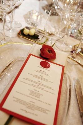 Wedding menu with orange border and wax seal