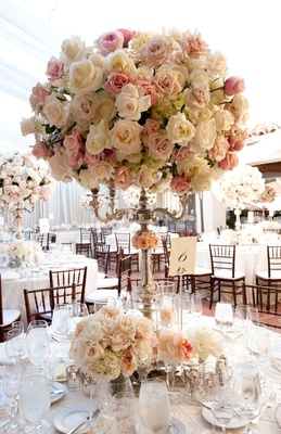 Silver candelabra wedding arrangement with blush flowers