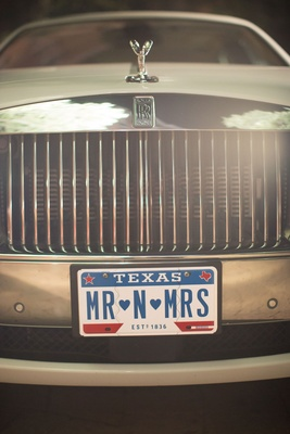 Rolls-Royce wedding car getaway limousine with Mr n Mrs Texas personalized plate