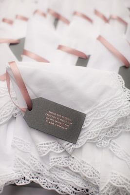 White handkerchiefs for parents and wedding party with note describing surprise wedding