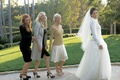 Bride in white jacket and ball skirt with Daryl Hannah