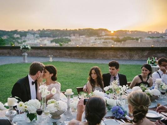reception table with sunset view of rome