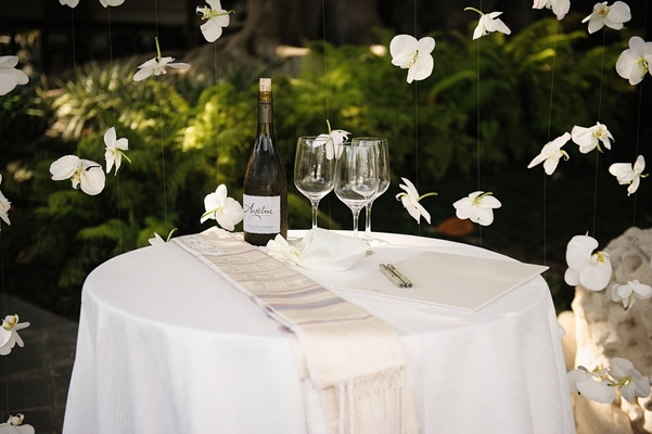 Interfaith wedding table with wine and wine glasses jewish and christian traditions