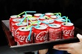 Mini Coke cans with blue and green straws
