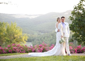 bride in marchesa wedding dress long sleeves v back mermaid, groom in white tuxedo, tuscany road