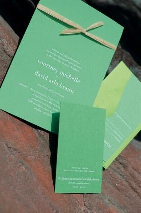 Bright rectangular invites tied with raffia