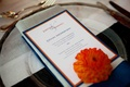 Personalized wedding menu with blue and orange border