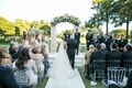 Bride's father escorts her to groom at ceremony Dallas Country Club green manicured lawn