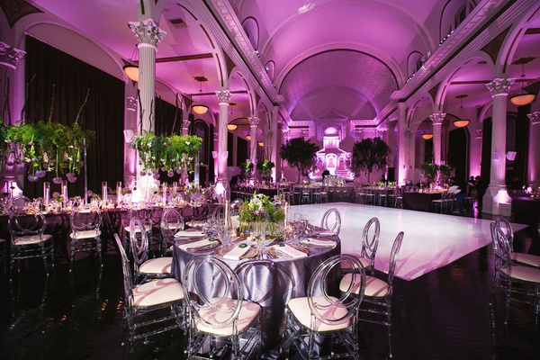 Wedding reception vibiana white dance floor purple lighting linens greenery centerpiece modern chair