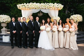 Bride and groom at outdoor ceremony with bridesmaids and groomsmen
