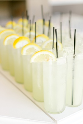 lemonade with fresh lemon slices for guests before wedding ceremony