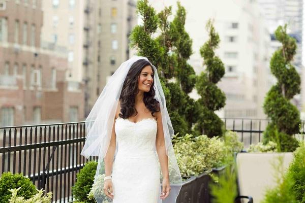 Bride in white strapless dress on rooftop garden