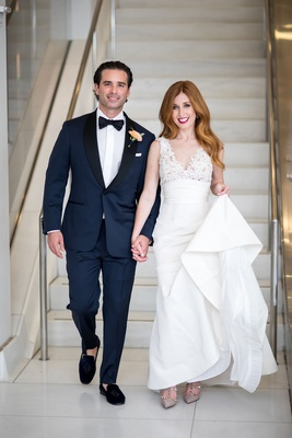 Bride in v neck wedding dress mark ingram atelier and groom in navy tuxedo with slipper shoes