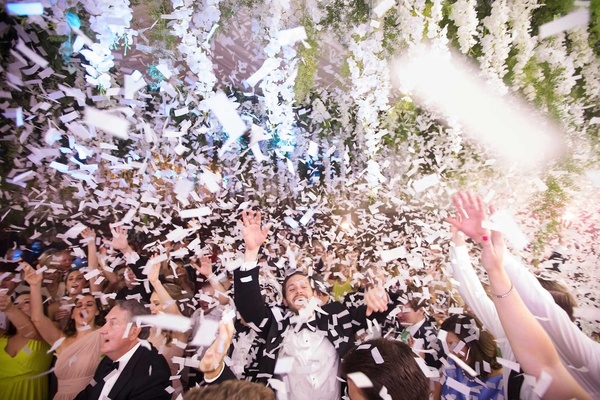 wedding reception dance floor confetti guests live band flower ceiling installation