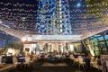 wedding reception hotel figueroa outdoor lounge string lights mural lounge furniture rentals