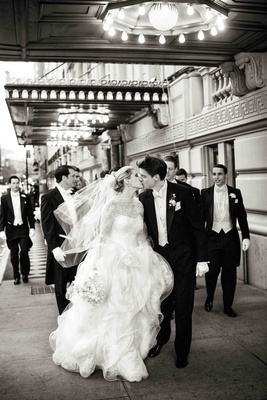 B&W photo of bride and groom kiss in NYC