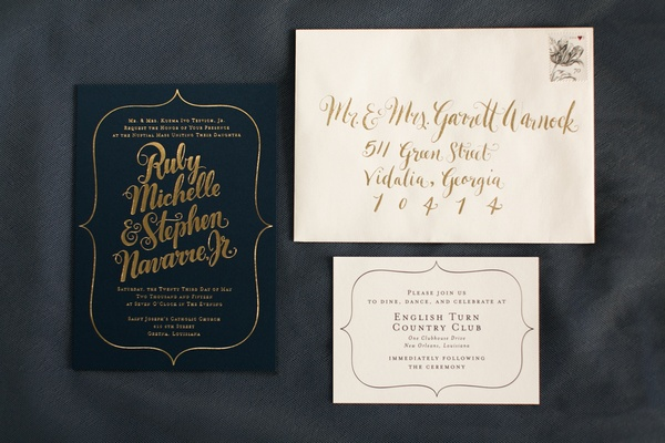 Wedding invitation suite in dark blue paper and gold script, calligraphy by Kelly Draws