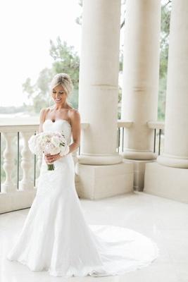 bridal portrait wedding photo strapless angel rivera wedding dress with bouquet flowers by cina