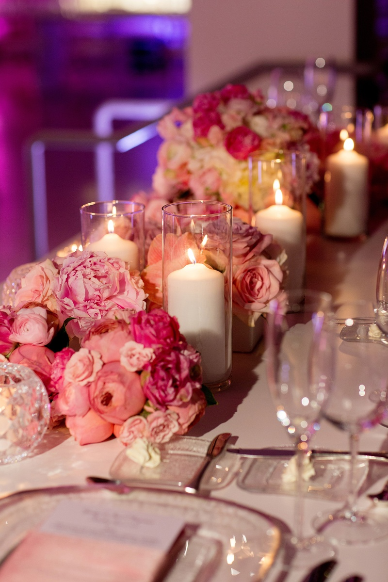 Reception dcor photos pink flowers and candles inside weddings low bundles of pink flowers and white pillar candles junglespirit Images