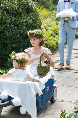 wedding ceremony outdoor blue wagon flower girls flower crown lace dress moss basket