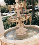 Large water fountain decorated with flowers