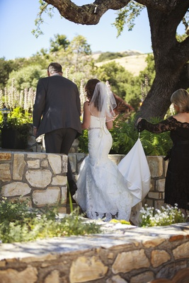 Bride in a strapless Essence of Australia lace gown, beaded sash, with father in a grey suit