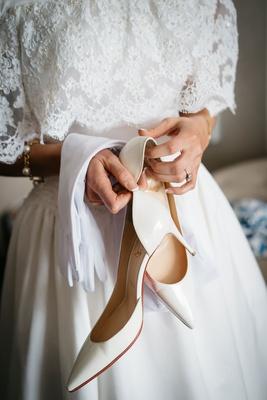 wedding portrait close up bride white christian louboutin shoes pumps white gloves lace dress