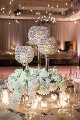 bejeweled candles low floral arrangements classic wedding reception roses greenery wine glasses