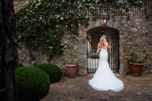 Brock Osweiler's bride Erin Costales in Demetrios wedding dress