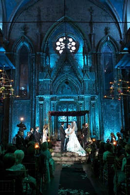 venue with high ceilings and gothic architecture lit with blue lighting