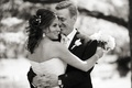 Black and white photo of bride and groom hugging