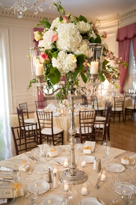 Silver candelabra wedding centerpiece with hydrangea and rose
