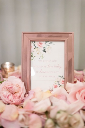 wedding ceremony table for deceased loved ones late loved ones pink flower rose gold frame signage