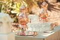 Outdoor wedding with copper coffee dispenser display glasses sugar and stirring sticks
