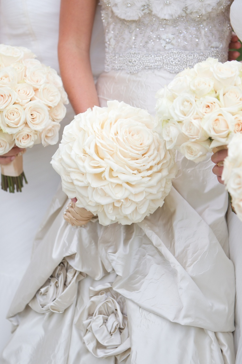 Bride glamelia rose bouquet and bridesmaid white roses bouquets