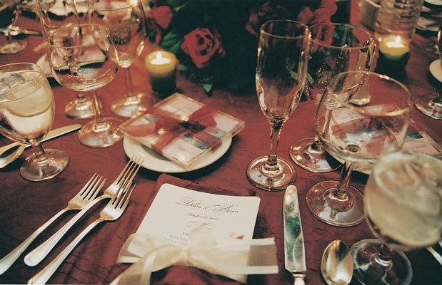 Red reception table with ivory menu and cd wedding favor