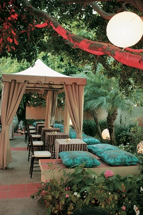 Backyard lounge space with pillows and tables