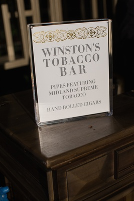 Hand rolled cigar station sign at wedding reception