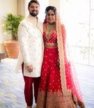 Bride and groom in traditional indian wedding attire bride in lehnga and groom in sherwani