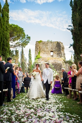 Wedding ceremony held near the hill top ruins of an ancient castle in Tuscany