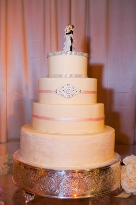 Four layer cake with pink ribbons and rhinestones