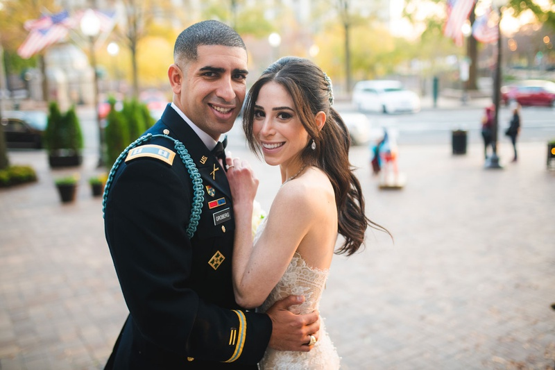 wedding couple portrait groom in military uniform bride in strapless gown ponytail hairstyle
