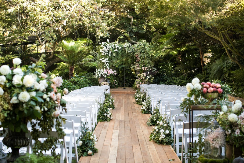 wedding ceremony hotel bel-air geller events the hidden garden fall flowers white chairs wood plank