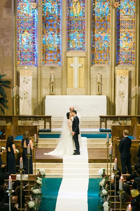 bride in pretty wedding dress with special ceremony top and groom kiss at altar westwood church la