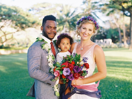 bride and groom with daughter at wedding in hawaii, bride with flower crown