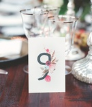 Table number with floral illustration by Rifle Paper Co.