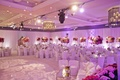 Ballroom illuminated with purple lighting and roses
