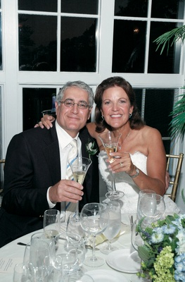Wedding couple toast champagne at sweetheart table