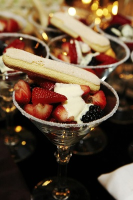 Martini glasses filled with berries and cream