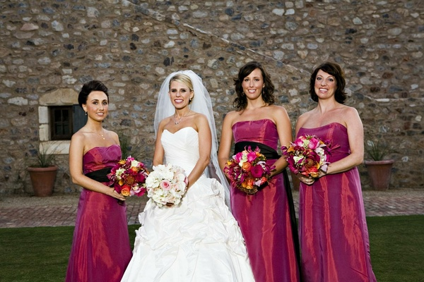 Fall Wedding With Black Bridesmaid Dresses : Dark pink strapless bridesmaid dresses with black sash